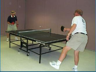 Senior citizens playing table tennis